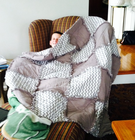 """Kevin """"The Blanket Thief"""" McDermott trying to steal one of my quilts."""